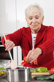 Grandma cooking — Stock Photo
