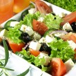 Tasteful garnished greek salad — Stock Photo #37166963