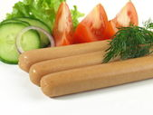 Tasty sausages for breakfast with garnish — Stock Photo
