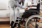 Sitting down on wheelchair — Stock Photo