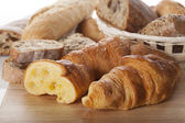 Fresh bread and croissants — Stock Photo