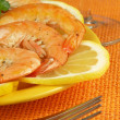 Prawns on lemon slices — Stock Photo