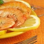 Prawns on lemon slices — Stock Photo #37247841