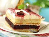 Cake with cherries and cream — Stock Photo