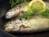 Trouts ready for frying, closeup — Stock Photo