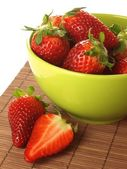 Strawberries in a green bowl, closeup — Stock Photo