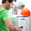 Handyman repairing boiler — Stock Photo