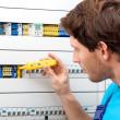 Repairman fixing a switchboard — Stock Photo