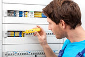 Repairman fixing a switchboard — Stock Photo