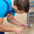 Plumber fixing the radiator — Stock Photo #37470009