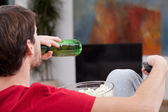 Match time, man with beer — Stock Photo
