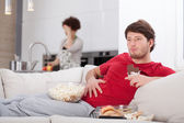 Lazy guy and his hard-working wife — Stock Photo