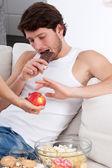 Boy prefers chocolate than apple — Stock Photo