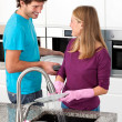 Happy couple cleaning together — Stock Photo