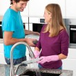 Stock Photo: Happy couple cleaning together