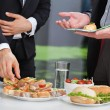 Business people at lunch buffet — Stock Photo