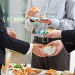 Foto Stock: Business breakfast in office