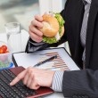 Stock Photo: Quick business meal at work