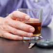 Driver with glass of whisky — Stock Photo