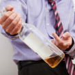 Stock Photo: Businessmoffering alcohol