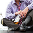 Stock Photo: Depressed businessmdrinking alcohol