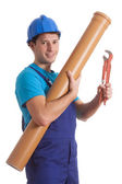 Worker with tube and spanner — Stock Photo