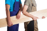 Builders with board — Stock Photo
