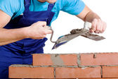 Builder using a cement and trowel — Stockfoto