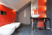 Red and grey bathroom — Stock Photo