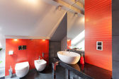 Red bathroom interior — Stock Photo