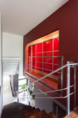 Stairs and a red wall — Foto Stock