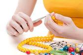 Yellow bead necklace — Stock Photo