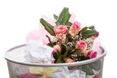 Flowers in dustbin — Stock Photo