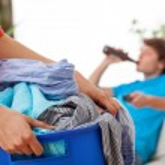 Woman holding laundry — Stock Photo