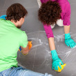 Stock Photo: Couple during housework