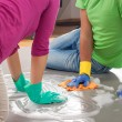 Stock Photo: Couple cleaning floor