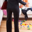 Stock Photo: Businesswomsurprised mess at home