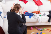 Modern woman can't stand a house mess — Stock Photo