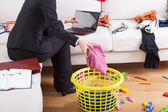Active woman cleaning house and working — 图库照片