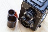 Câmera e rolo — Fotografia Stock