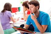 Students thinking about difficult exercise — Stock Photo