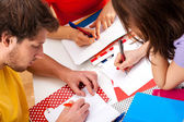 Active students doing a project together — Stock Photo