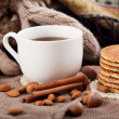 Hot drink, cinnamon and nuts — Stock Photo #39219475