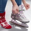 Putting on skates — Stock Photo