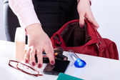 Woman packing handbag — Stock Photo