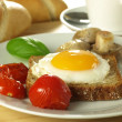 Stock Photo: Sunny side up egg on slice of bread