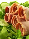 Rolled sirloin with lettuce, closeup — Stock Photo