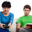 Stock Photo: Elderly womplaying vdeo game