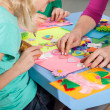 Children making decorations on paper — Stock Photo