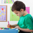 Little boy drawing on the art lesson — Stock Photo
